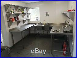 Commercial kitchen equipment stainless steel shelves, tables, double sink